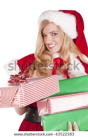 Mrs Santa is handing a present. - stock photo