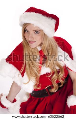 Mrs Santa is sitting on the ground. - stock photo