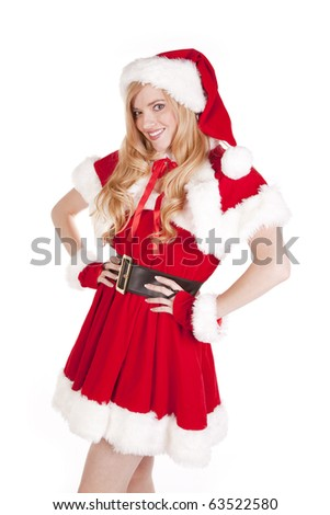 Mrs Santa is standing and smiling. - stock photo