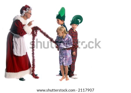 Mrs. Santa tying up her elves in a Christmas garland after catching them breaking the rules