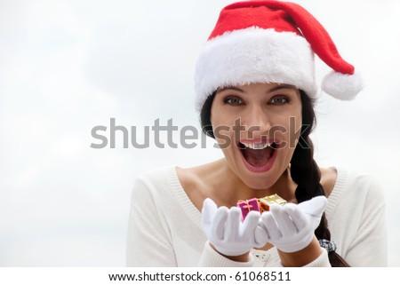 Mrs. Santa with a gift box - stock photo