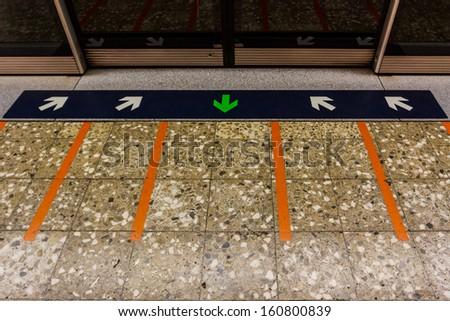 MRT station platform edge. Painted waiting line on the floor. - stock photo