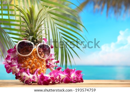 Ms pineapple on beach table - stock photo