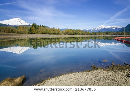 Mt Baker and Mt Shuksan reflected in a Lake - stock photo