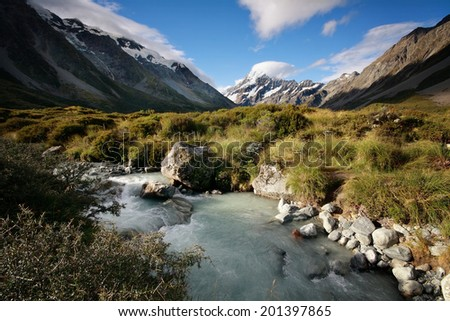 Mt Cook (Aoraki) seen from Hooker Valley in New Zealand on a sunny summer day - stock photo