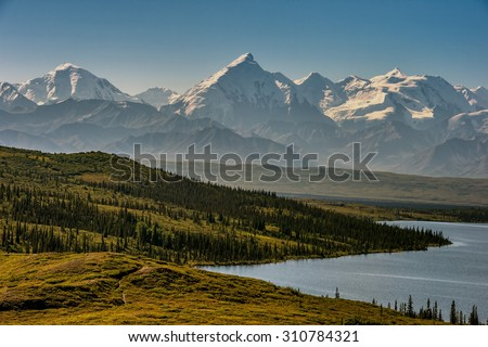 mt denali on clear morning from wonder lake - stock photo