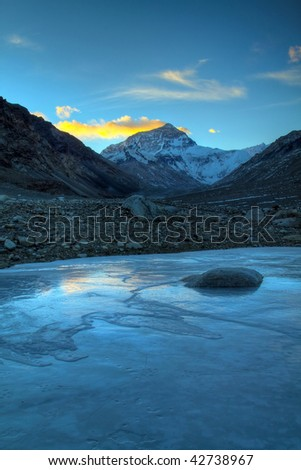 Mt. Everest in the dawn viewed from the base camp - stock photo