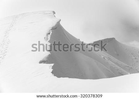 Mt Feathertop summit ridge with cornice in winter. Victoria, Australia. Black and White image. - stock photo