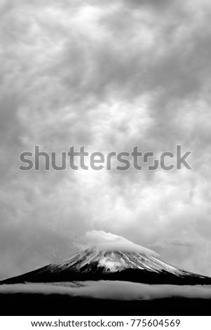 Mt. Fuji or Mount Fujisan or Fujiyama mountain against rainy cloud. View from Fujikawaguchiko city, Yamanashi prefecture, Japan. (Black and White)