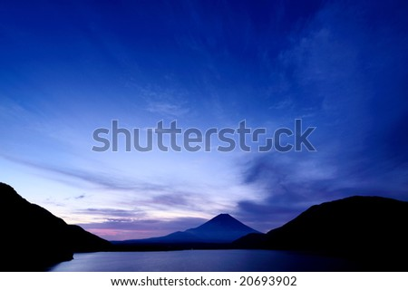 Mt. Fuji which became the silhouette at a sunset - stock photo