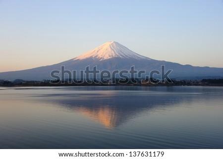 Mt. Fuji with its reflection on Lake Kawaguchiko - stock photo