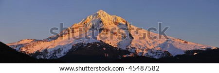 Mt Hood panorama with blue sky at sunset - stock photo