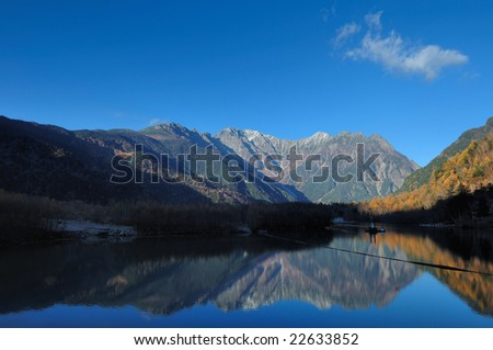 Mt. Hotaka mountain range to see from the Japanese Alps Taisho pond - stock photo