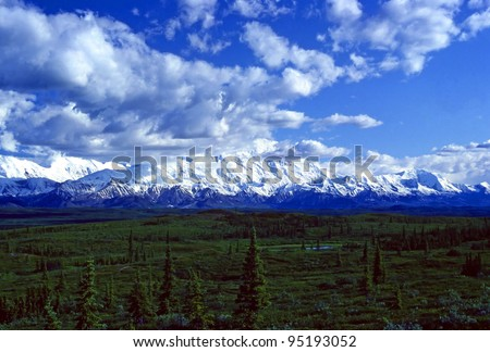 Mt Mckinley Breaking through afternoon clouds in Denali National park - stock photo