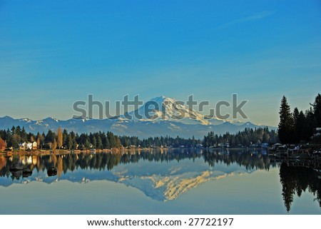 Mt. Rainier reflecting in Lake Tapps, Sumner Washington. - stock photo