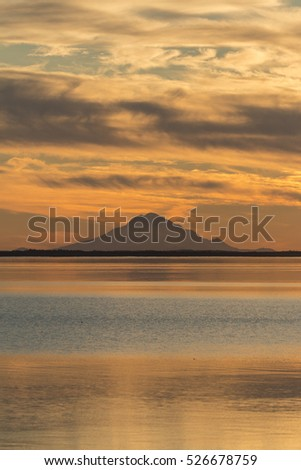 Mt. Redoubt and Skilak Lake at sunset in Alaska.
