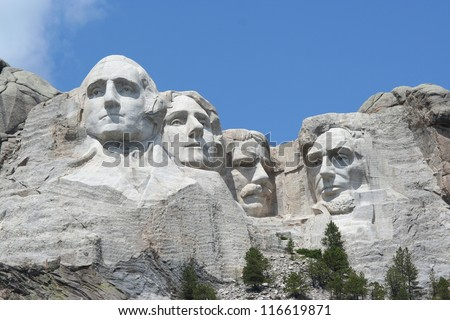 Mt. Rushmore, photographed from the base. Bright sunny day. - stock photo