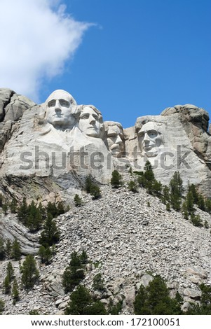 Mt. Rushmore with Rockpile. Mt. Rushmore, photographed from the base. Bright sunny day. - stock photo