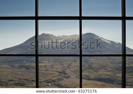 Mt. Saint Helens seen from windows of the Johnston Ridge Visitors Center - stock photo