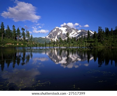Mt. Shuksan, in North Cascades National Park, reflecting in Picture Lake which is located in the Snoqualmie National Forest of Washington State. - stock photo