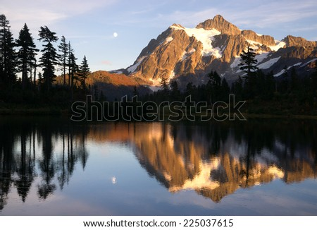 Mt. Shuksan reflected in smooth Picture Lake at sunset North Cascades National Park. - stock photo