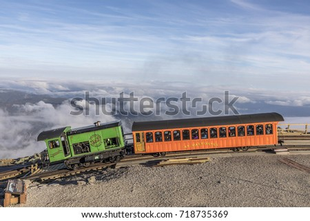 MT WASHINGTON, NH, USA - SEP 19, 2017: Mount Washington Cog Railroad at the top of Mount Washington in White Mountain in fall, New Hampshire, USA.