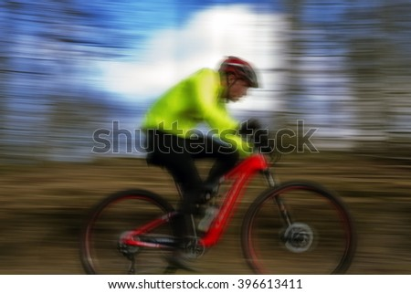 MTB action - mountain bike cross-country race in Denmark. - stock photo