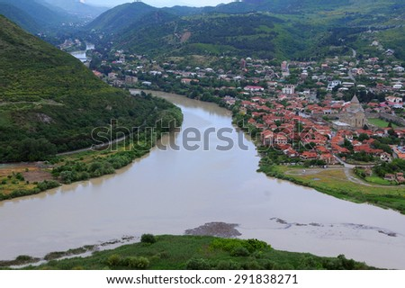 MTSKHETA, GEORGIA - JUNE 14, 2015: View of the town and Svetitskhoveli Cathedral and confluence of the Aragvi and Kura rivers from Jvari monastery 12 miles north of Tbilisi - stock photo