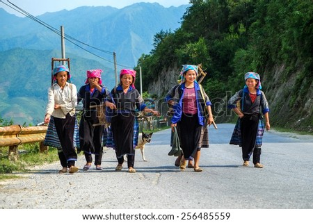 MU CANG CHAI, VIETNAM - MAY 16, 2014 - unidentified H'mong woman group in Mu Cang Chai, Yen Bai, Vietnam at May 16, 2014. H'mong are the 8th largest ethnic group in Vietnam. - stock photo