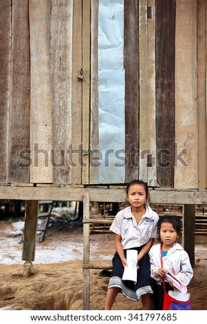 MUANG KHUA,LAOS-OCTOBER 09, 2015:  Students come to receive visits by tourists on October 09, Muang Khua, Laos.
