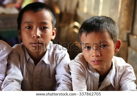 MUANG KHUA,LAOS-OCTOBER 09, 2015:  Students come to receive visits by tourists out of curiosity on October 09, Muang Khua, Laos.
