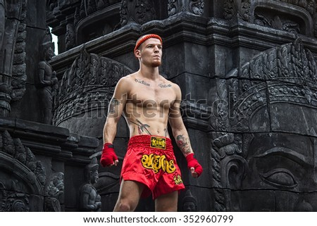 Muay Thai fighter preparing to fight - stock photo