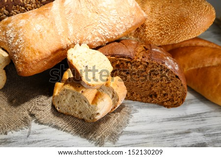 Much bread on sackcloth on wooden board