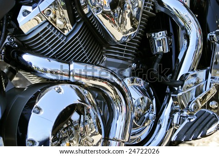 much chromium on engine of the motorcycle - stock photo