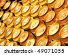 Much of gold beer cans close up - stock photo