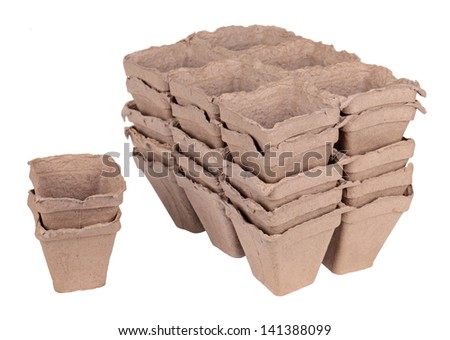 Much peat pots for growing seedlings, isolated on white background - stock photo