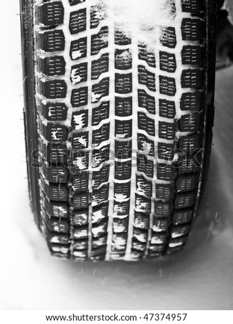 Mud and snow tire tread packed with snow - stock photo