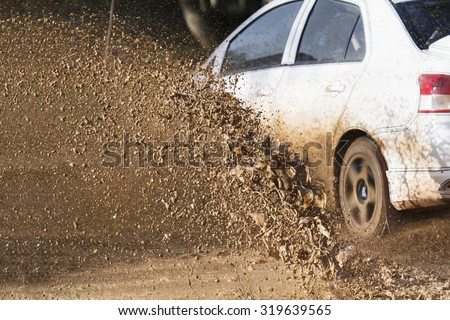 Mud debris splash from a rally car ( Focus at mud debis) - stock photo