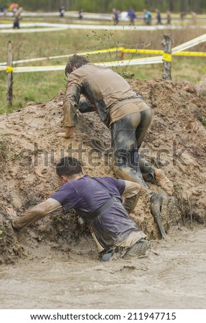 Mud race runners - stock photo