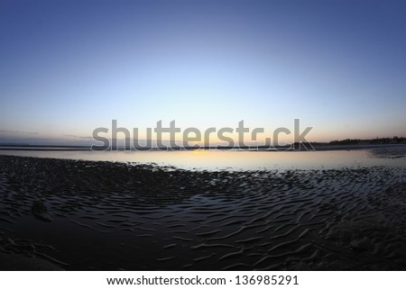 mud ripple typical of only sandgate brisbane beach copy space background australia - stock photo