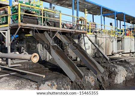 mud shaker and slide - stock photo