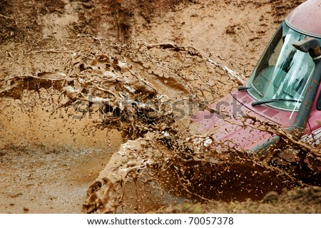 Mud splashing off an off road vehicle - stock photo