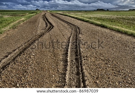 Mud Tire Tracks after a storm in the Canadian Prairies - stock photo