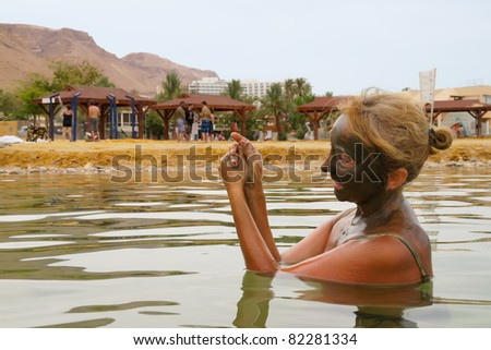 Mud treatment at the Dead Sea. Israel - stock photo