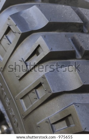 Mud Tyres close up of sidebiters - stock photo