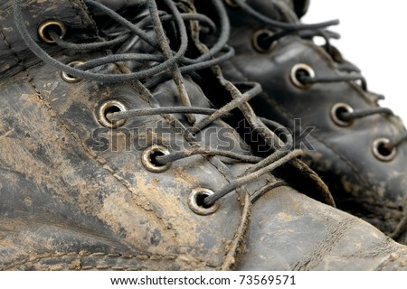 Muddy boots detail - stock photo
