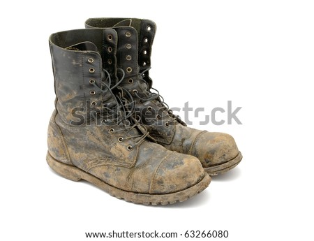 Muddy boots isolated on white background - stock photo