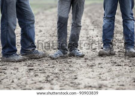 Muddy Hiking Boots - stock photo