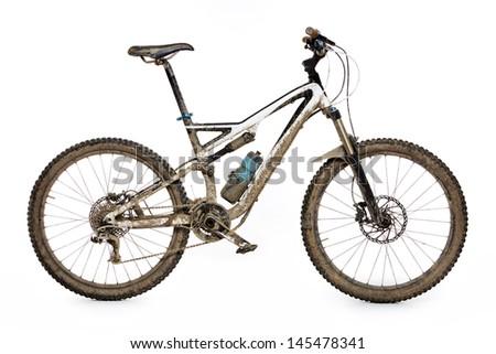 Muddy mountain bike isolated on white background - stock photo
