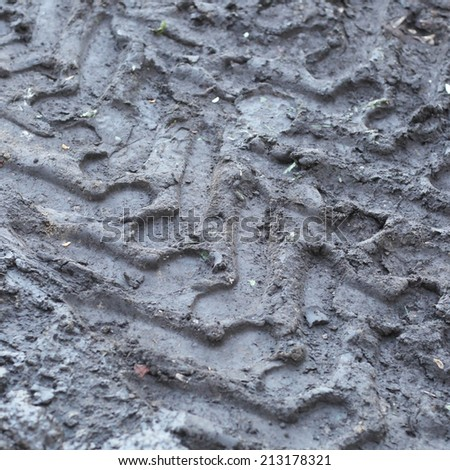 muddy puddle road after rain - stock photo
